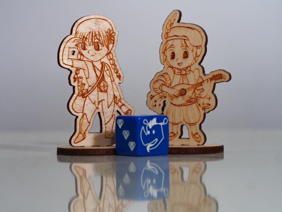 W zestawie recenzenckim były między innymi dwie figurki oraz kostka.